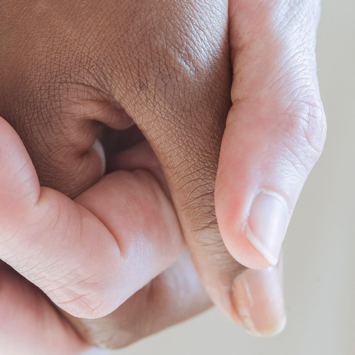 An image of a couple holding hands