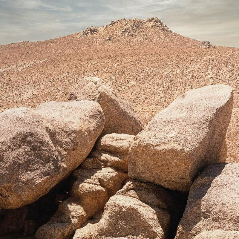An image of heavy rocks in a desert. They represent the listless and aching feeling some people experience in their legs after chemotherapy