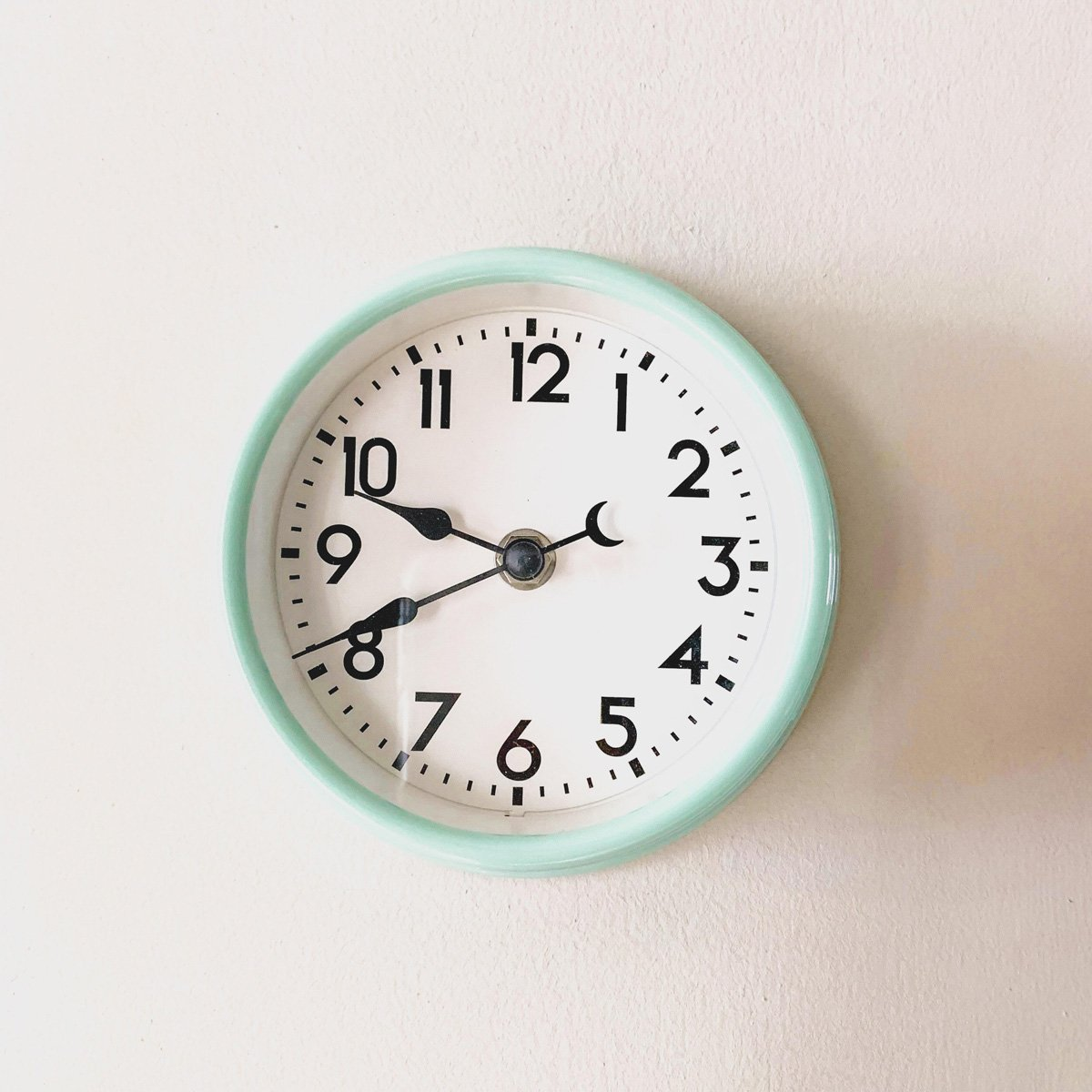 An image of an analogue clock hanging on a wall